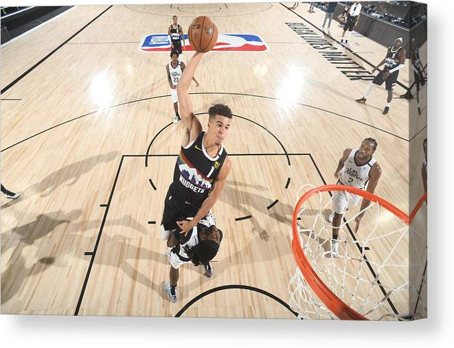 Playoffs Canvas Print featuring the photograph LA Clippers v Denver Nuggets - Game Three by Andrew D. Bernstein