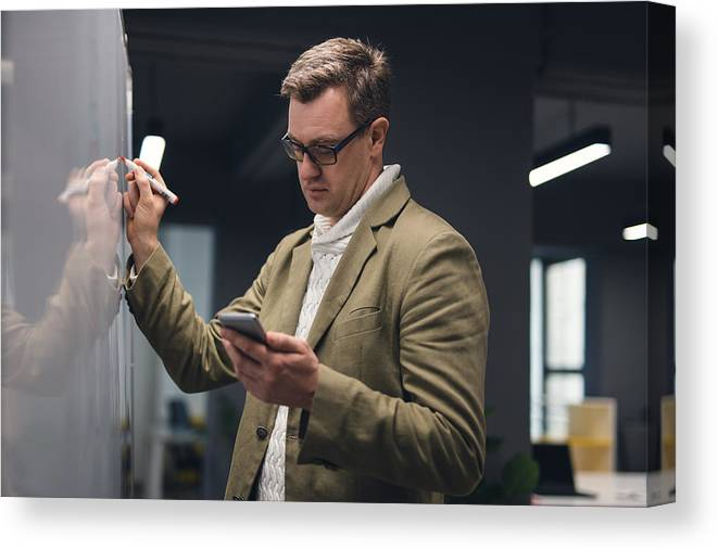 New Business Canvas Print featuring the photograph Man In Modern Office Writing On The Board by Chabybucko