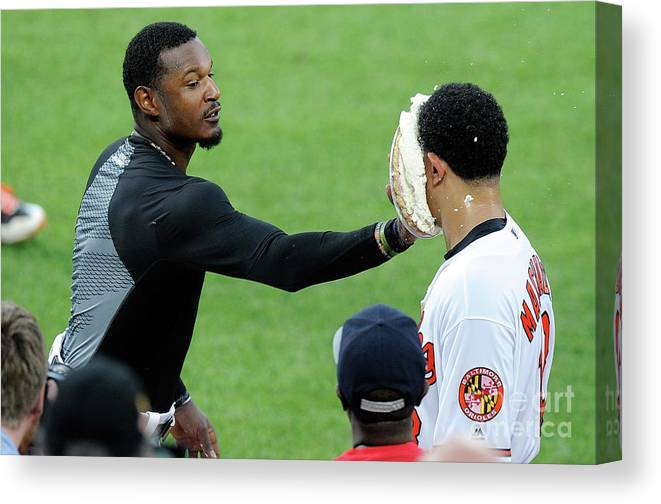People Canvas Print featuring the photograph Manny Machado and Adam Jones by Greg Fiume