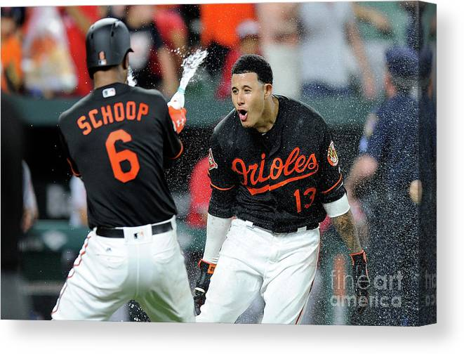 Three Quarter Length Canvas Print featuring the photograph Manny Machado and Jonathan Schoop by Greg Fiume