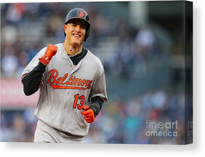 Three Quarter Length Canvas Print featuring the photograph Manny Machado and Matt Wieters by Mike Stobe