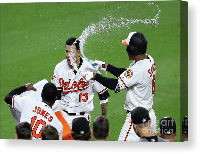 People Canvas Print featuring the photograph Manny Machado, Jonathan Schoop, and Adam Jones by Rob Carr