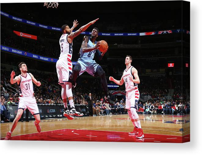 Nba Pro Basketball Canvas Print featuring the photograph Markieff Morris and James Ennis by Ned Dishman