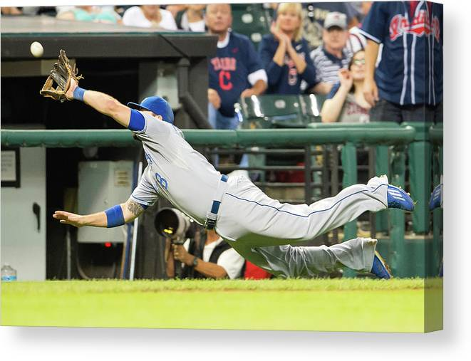 American League Baseball Canvas Print featuring the photograph Mike Moustakas and Lonnie Chisenhall by Jason Miller