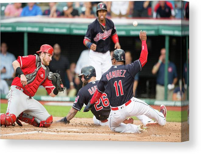 Baseball Catcher Canvas Print featuring the photograph Mike Napoli, Lonnie Chisenhall, and Jett Bandy by Jason Miller