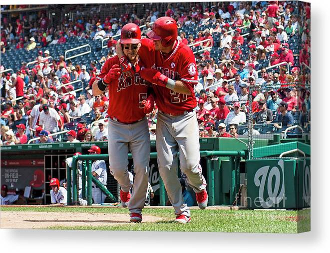 People Canvas Print featuring the photograph Mike Trout and Kole Calhoun by Patrick Mcdermott