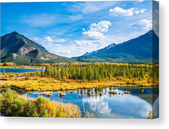 Tranquility Canvas Print featuring the photograph Minnewanka lake in Canadian Rockies in Banff Alberta Canada by WanRu Chen