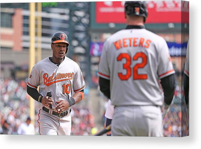 American League Baseball Canvas Print featuring the photograph Nelson Cruz and Adam Jones by Leon Halip