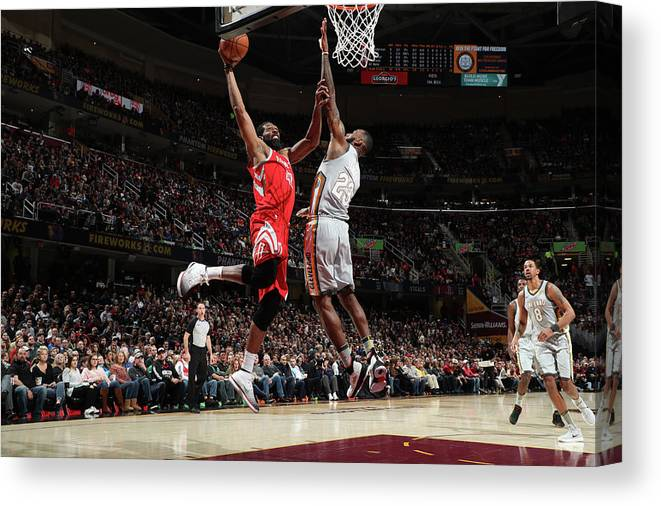 Nba Pro Basketball Canvas Print featuring the photograph Nene Hilario and Lebron James by Joe Murphy