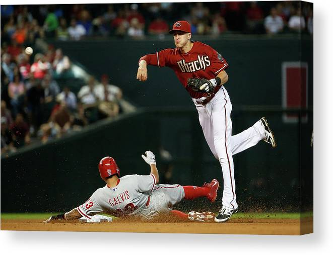 Double Play Canvas Print featuring the photograph Nick Ahmed and Freddy Galvis by Christian Petersen