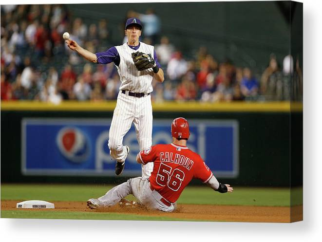 Double Play Canvas Print featuring the photograph Nick Ahmed and Kole Calhoun by Christian Petersen