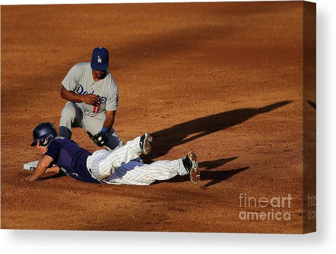 Game Two Canvas Print featuring the photograph Nick Hundley and Jimmy Rollins by Doug Pensinger