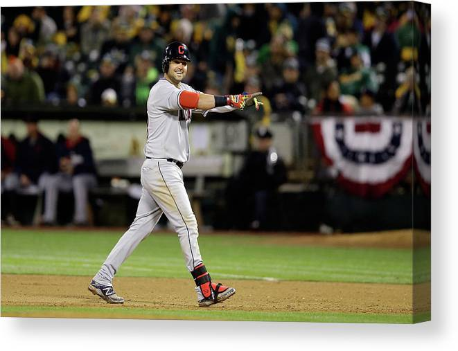 American League Baseball Canvas Print featuring the photograph Nick Swisher and Nyjer Morgan by Ezra Shaw
