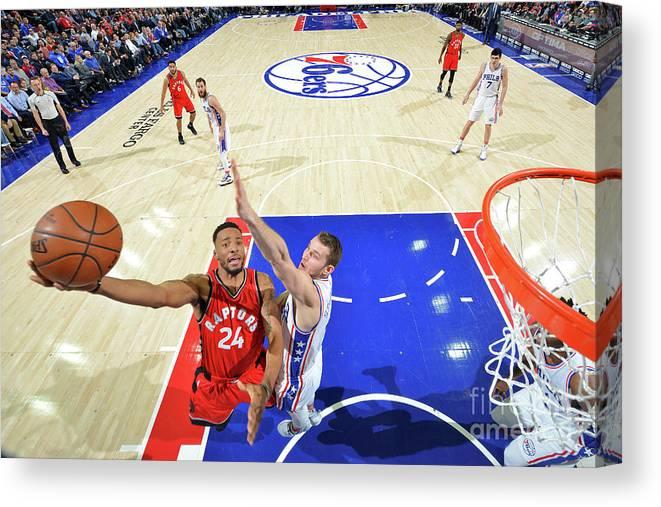 Nba Pro Basketball Canvas Print featuring the photograph Norman Powell and Nik Stauskas by Jesse D. Garrabrant