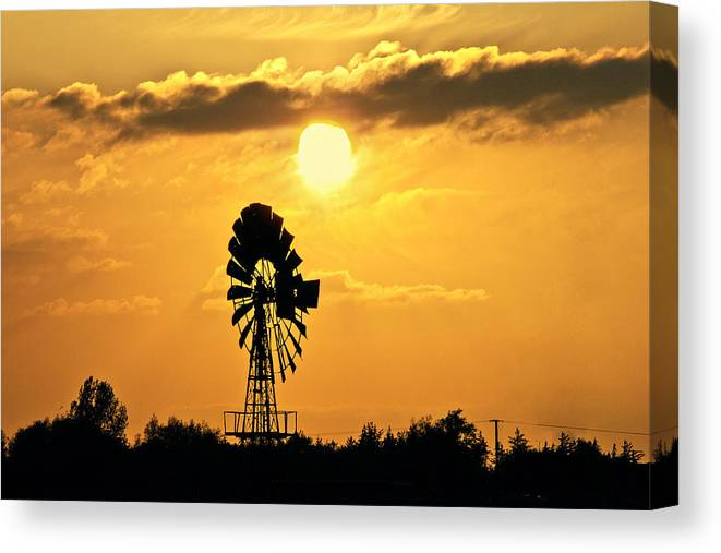 Sky Canvas Print featuring the photograph Old Windmill At Sunset by Bernd Schunack