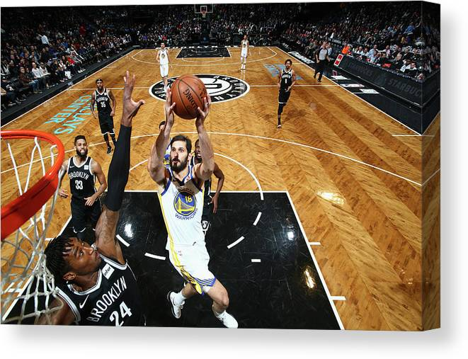 Nba Pro Basketball Canvas Print featuring the photograph Omri Casspi by Nathaniel S. Butler