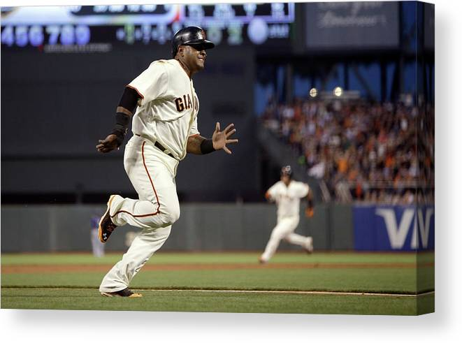 San Francisco Canvas Print featuring the photograph Pablo Sandoval and Brandon Crawford by Ezra Shaw