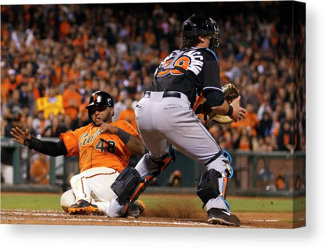 San Francisco Canvas Print featuring the photograph Pablo Sandoval and Jarrod Saltalamacchia by Jason O. Watson