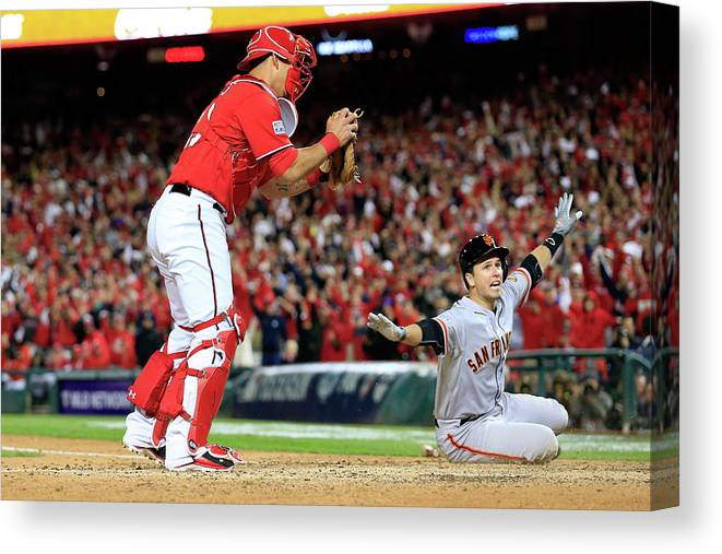 Game Two Canvas Print featuring the photograph Pablo Sandoval, Wilson Ramos, And Buster Posey by Rob Carr