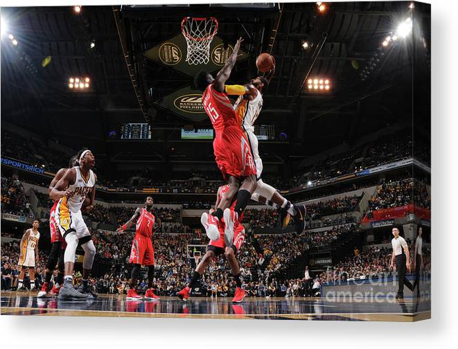 Nba Pro Basketball Canvas Print featuring the photograph Paul George and Clint Capela by Ron Hoskins
