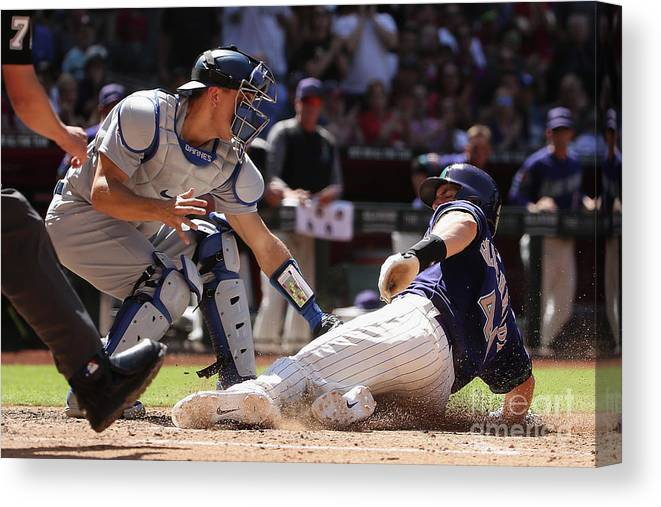 Baseball Catcher Canvas Print featuring the photograph Paul Goldschmidt and Austin Barnes by Christian Petersen
