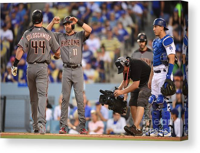 Game Two Canvas Print featuring the photograph Paul Goldschmidt and Austin Barnes by Harry How
