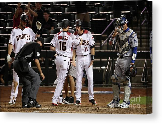 Ninth Inning Canvas Print featuring the photograph Paul Goldschmidt and Chris Owings by Christian Petersen