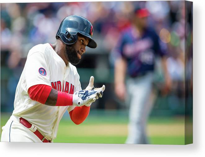 American League Baseball Canvas Print featuring the photograph Phil Hughes and Abraham Almonte by Jason Miller