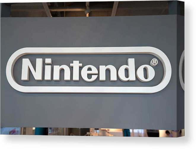 Corporate Business Canvas Print featuring the photograph Product Displays Inside The Nintendo Game Front Showroom by Bloomberg