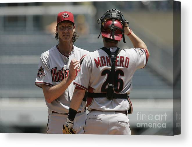 People Canvas Print featuring the photograph Randy Johnson and Miguel Montero by John Grieshop