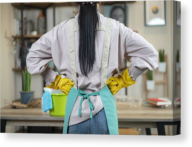 Homemaker Canvas Print featuring the photograph Rear Of Housewife Wear Apron Ready To Cleansing Home by Virojt Changyencham