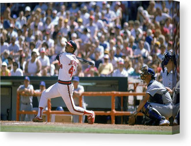 1980-1989 Canvas Print featuring the photograph Reggie Jackson by Mike Powell