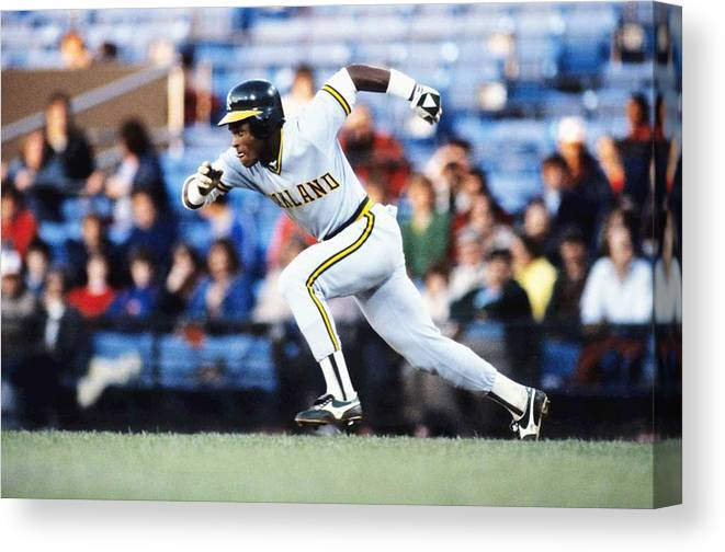1980-1989 Canvas Print featuring the photograph Rickey Henderson by Ronald C. Modra/sports Imagery