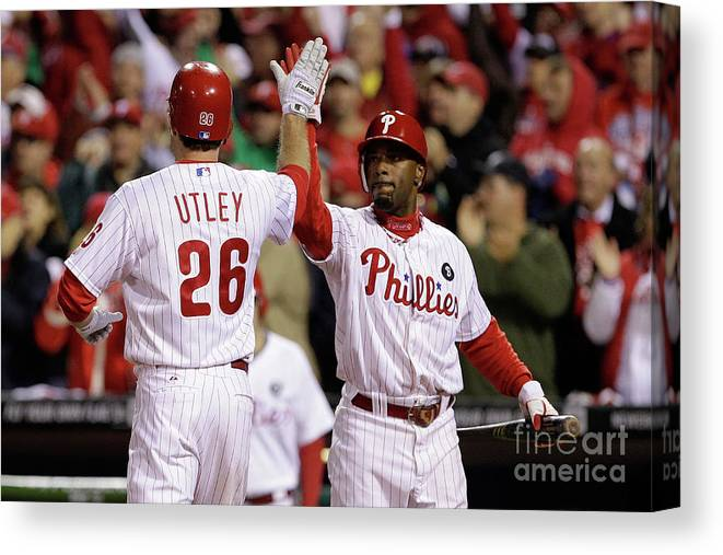 Game Two Canvas Print featuring the photograph Ryan Howard, Jimmy Rollins, and Chase Utley by Rob Carr