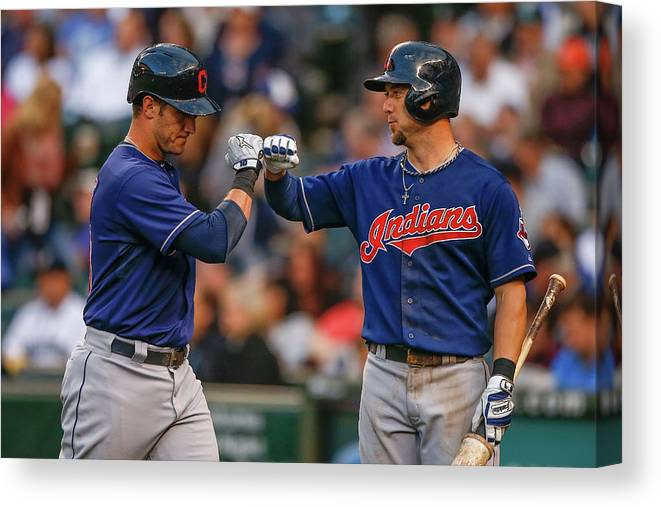 American League Baseball Canvas Print featuring the photograph Ryan Raburn and Yan Gomes by Otto Greule Jr
