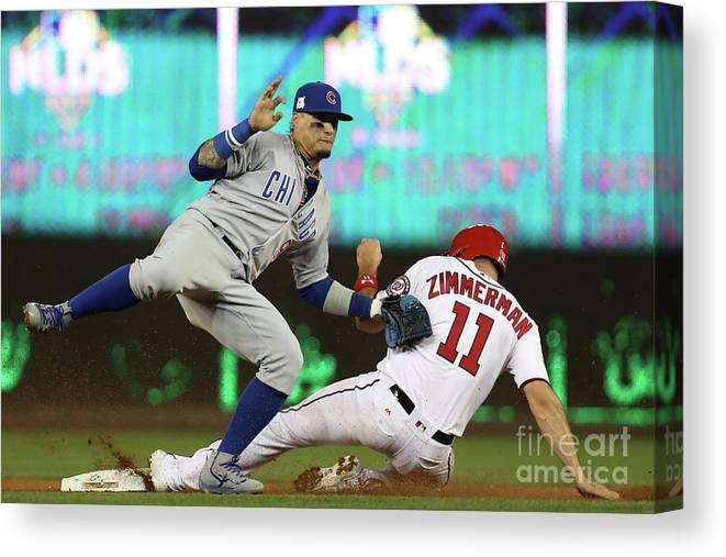 Game Two Canvas Print featuring the photograph Ryan Zimmerman and Javier Baez by Win Mcnamee