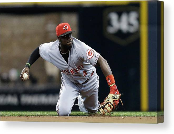 Retirement Canvas Print featuring the photograph Scooter Gennett and Brandon Phillips by Mike Mcginnis