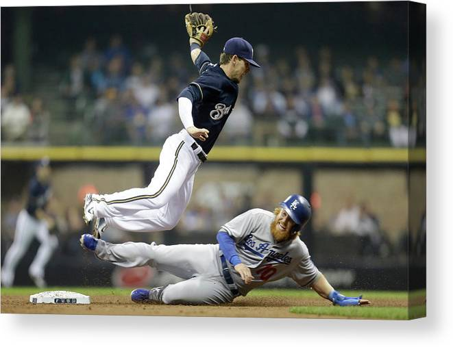 Double Play Canvas Print featuring the photograph Scooter Gennett And Justin Turner by Mike Mcginnis