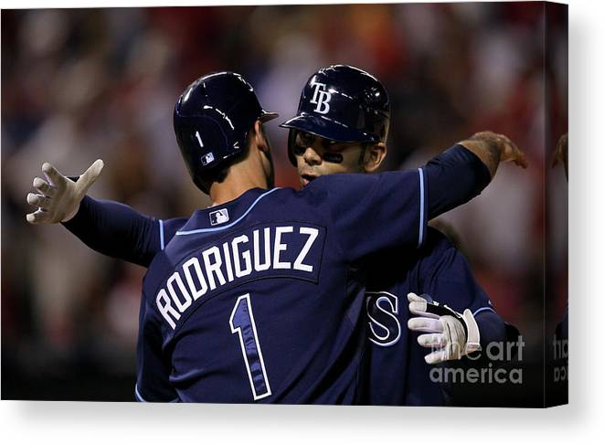Sean Rodriguez Canvas Print featuring the photograph Sean Rodriguez and Carlos Pena by Stephen Dunn