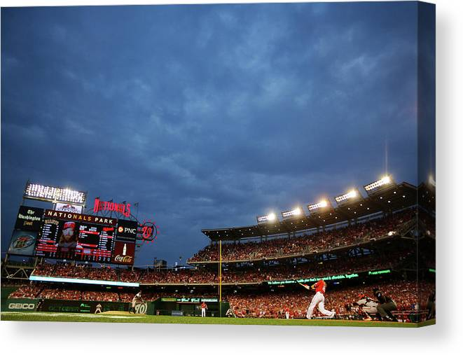 National League Baseball Canvas Print featuring the photograph Sergio Romo and Jayson Werth by Al Bello