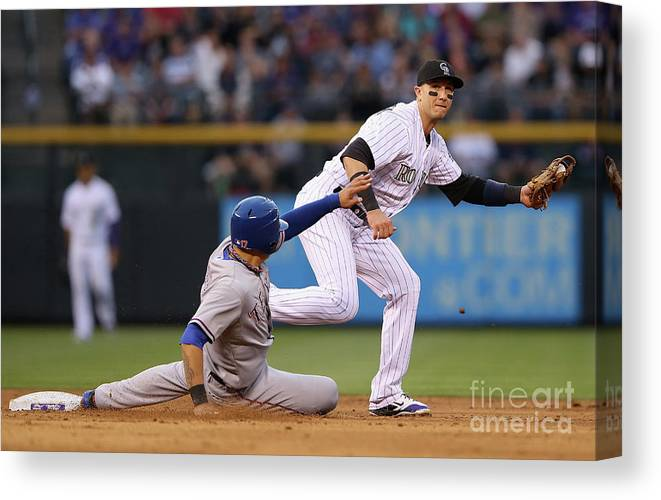 American League Baseball Canvas Print featuring the photograph Shin-soo Choo and Troy Tulowitzki by Doug Pensinger
