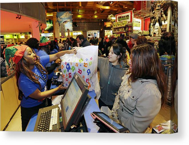 Thanksgiving Canvas Print featuring the photograph Shoppers Inside Toys R Us Inc. Stores Ahead Of Black Friday Sales by Bloomberg