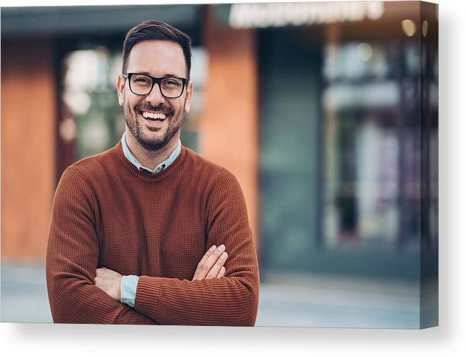 Bulgaria Canvas Print featuring the photograph Smiling man outdoors in the city by Pixelfit