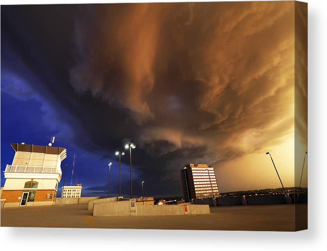 Thunderstorm Canvas Print featuring the photograph Squall line crossing overhead by Loren M Rye