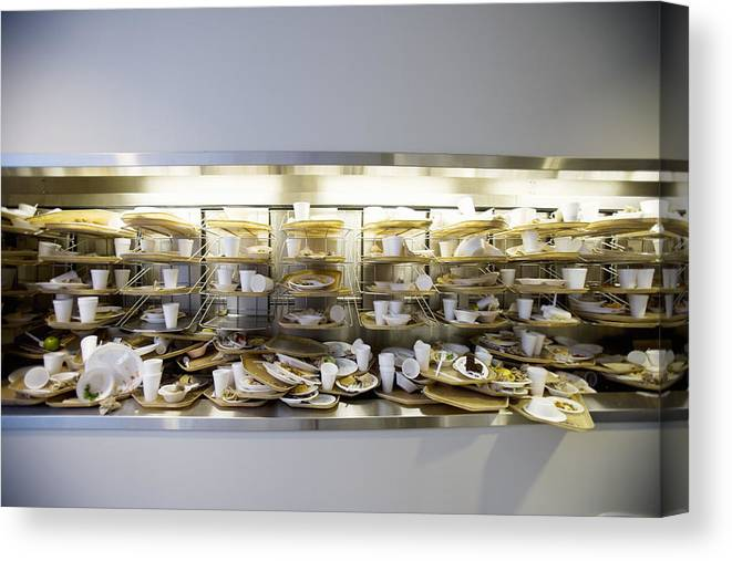 Cafeteria Canvas Print featuring the photograph Stack of dirty cafeteria trays by Cade Martin