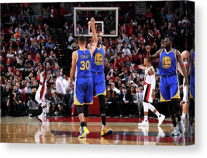 Nba Pro Basketball Canvas Print featuring the photograph Stephen Curry and Kevin Durant by Garrett Ellwood