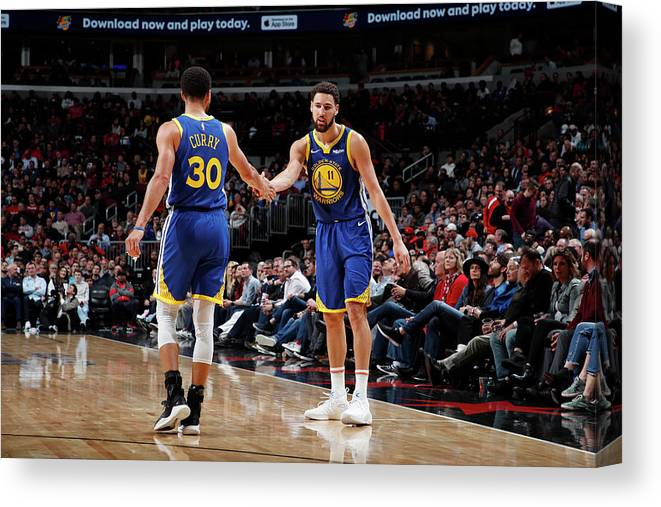 Nba Pro Basketball Canvas Print featuring the photograph Stephen Curry and Klay Thompson by Jeff Haynes