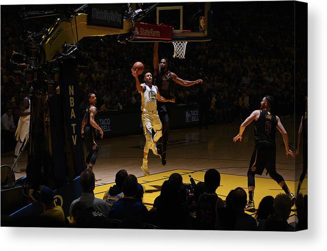 Playoffs Canvas Print featuring the photograph Stephen Curry and Tristan Thompson by Garrett Ellwood