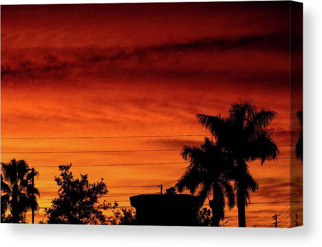 Sunset Canvas Print featuring the photograph The Fire sky by Daniel Cornell