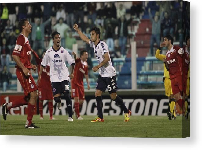 Copa Sudamericana Canvas Print featuring the photograph Tigre v Argentinos Juniors - Copa Sudamericana 2012 by LatinContent